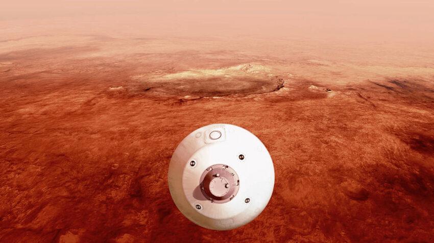 El aeroshell que contiene el rover Perseverance de la NASA se guía hacia la superficie marciana a medida que desciende a través de la atmósfera en esta ilustración.